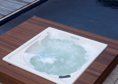 outdoor Jacuzzi with a wooden deck
